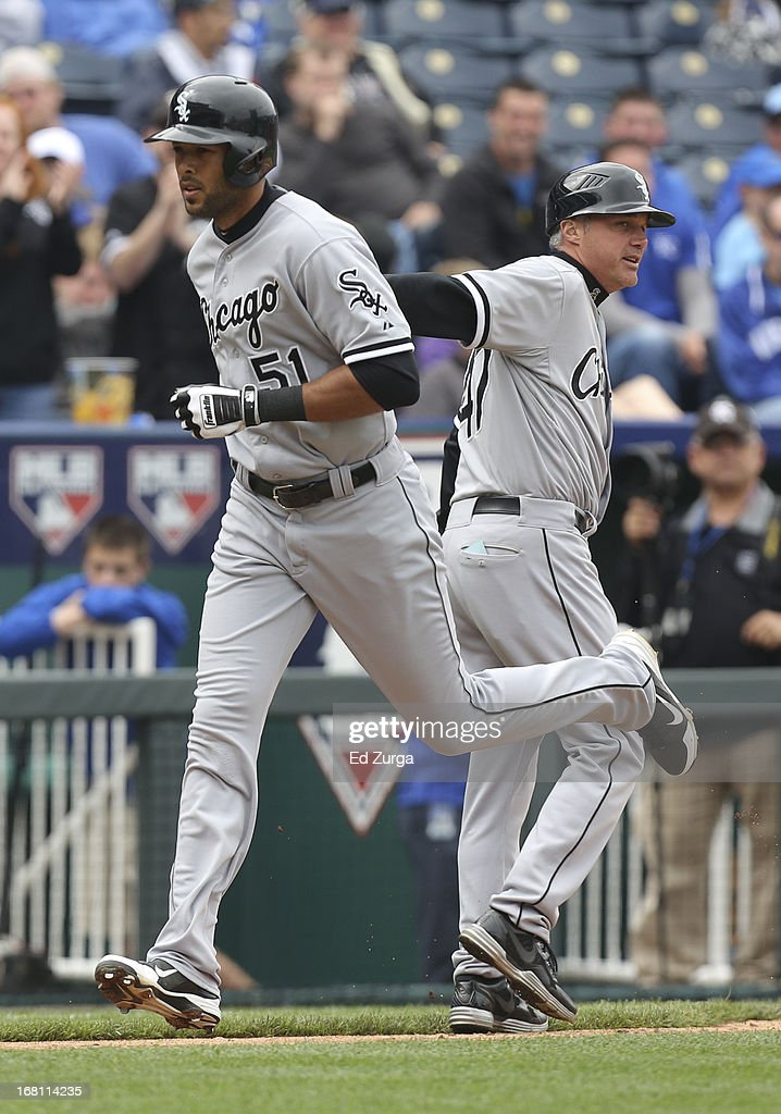 <a gi-track='captionPersonalityLinkClicked' href=/galleries/search?phrase=Alex+Rios&family=editorial&specificpeople=224676 ng-click='$event.stopPropagation()'>Alex Rios</a> #51 of the Chicago White Sox rounds third and is congratulated by <a gi-track='captionPersonalityLinkClicked' href=/galleries/search?phrase=Joe+McEwing&family=editorial&specificpeople=211298 ng-click='$event.stopPropagation()'>Joe McEwing</a> #41 after hitting a home run against the Kansas City Royals in the seventh inning at Kauffman Stadium on May 5, 2013 in Kansas City, Missouri.