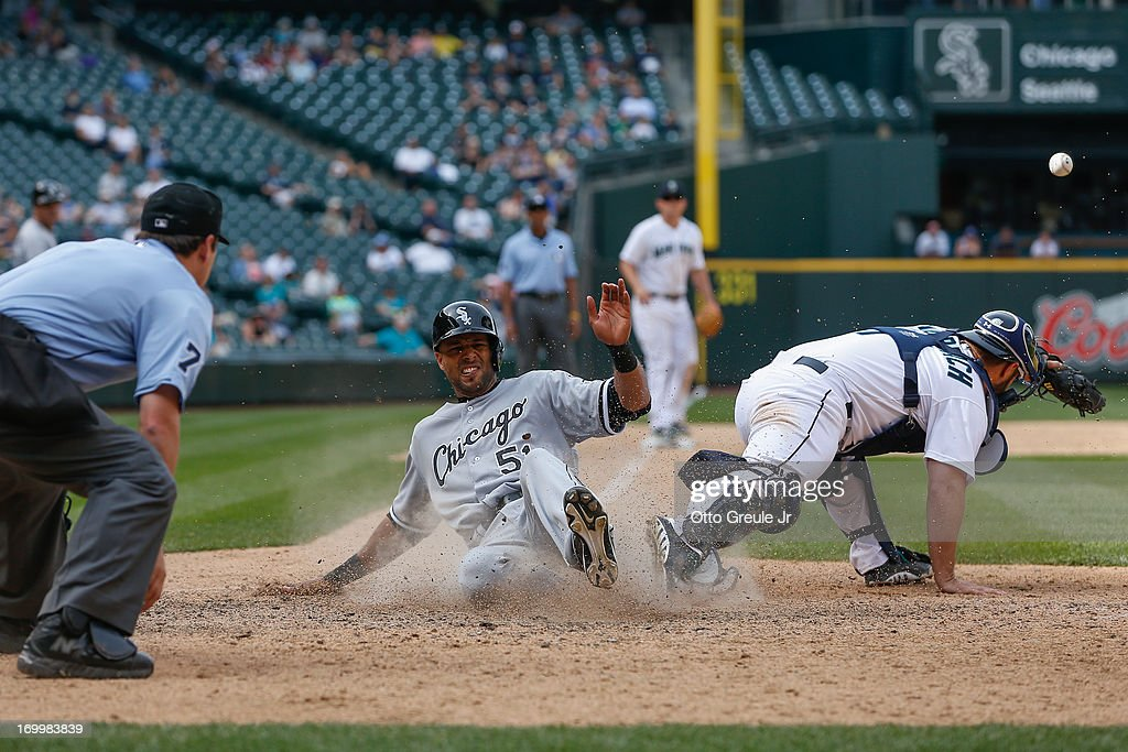 <a gi-track='captionPersonalityLinkClicked' href=/galleries/search?phrase=Alex+Rios&family=editorial&specificpeople=224676 ng-click='$event.stopPropagation()'>Alex Rios</a> #51 of the Chicago White Sox scores against catcher Kelly Shoppach #7 of the Seattle Mariners on an RBI single by Casper Wells in the fourteenth inning at Safeco Field on June 5, 2013 in Seattle, Washington.