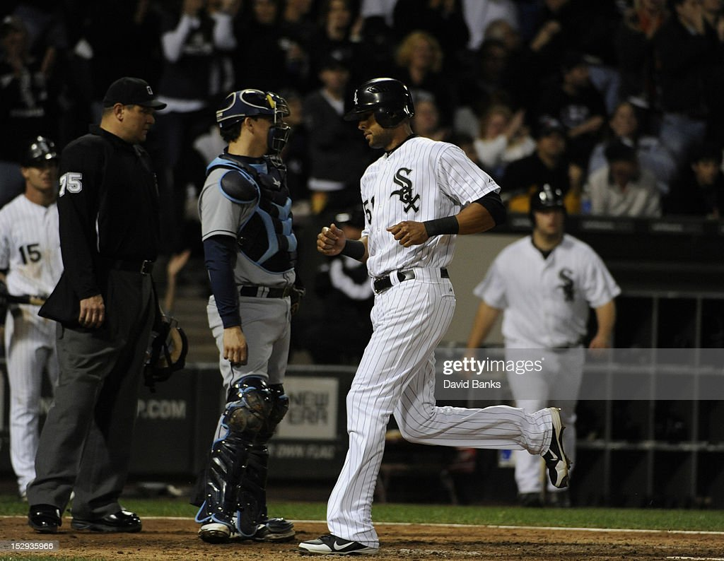 <a gi-track='captionPersonalityLinkClicked' href=/galleries/search?phrase=Alex+Rios&family=editorial&specificpeople=224676 ng-click='$event.stopPropagation()'>Alex Rios</a> #51 of the Chicago White Sox scores against the Tampa Bay Rays in the sixth inning on September 28, 2012 at U.S. Cellular Field in Chicago, Illinois.