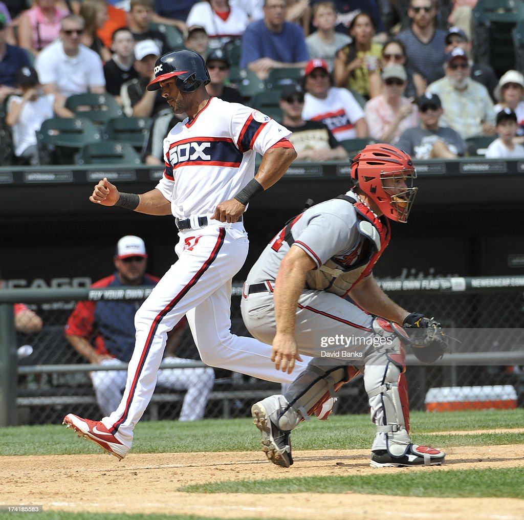 <a gi-track='captionPersonalityLinkClicked' href=/galleries/search?phrase=Alex+Rios&family=editorial&specificpeople=224676 ng-click='$event.stopPropagation()'>Alex Rios</a> #51 of the Chicago White Sox scores as <a gi-track='captionPersonalityLinkClicked' href=/galleries/search?phrase=Evan+Gattis&family=editorial&specificpeople=8977937 ng-click='$event.stopPropagation()'>Evan Gattis</a> #24 of the Atlanta Braves takes the throw during the sixth inning on July 21, 2013 at U.S. Cellular Field in Chicago, Illinois.