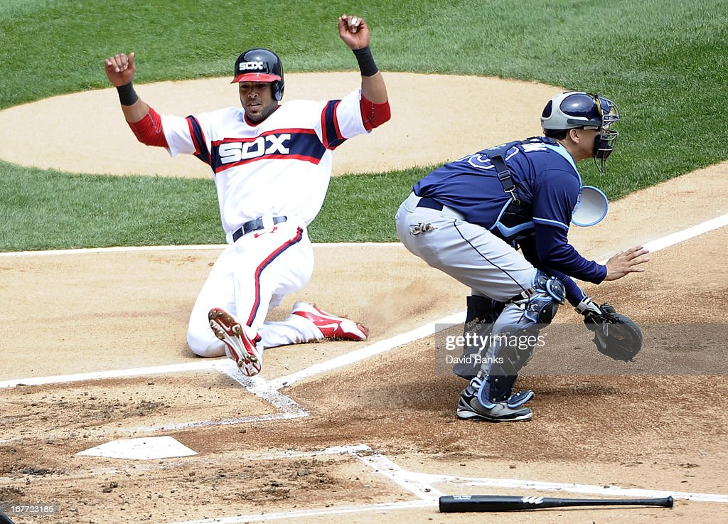 <a gi-track='captionPersonalityLinkClicked' href=/galleries/search?phrase=Alex+Rios&family=editorial&specificpeople=224676 ng-click='$event.stopPropagation()'>Alex Rios</a> #51 of the Chicago White Sox scores as Jose Lobaton #59 of the Tampa Bay Rays takes the throw during the first inning on April 28, 2013 at U.S. Cellular Field in Chicago, Illinois.