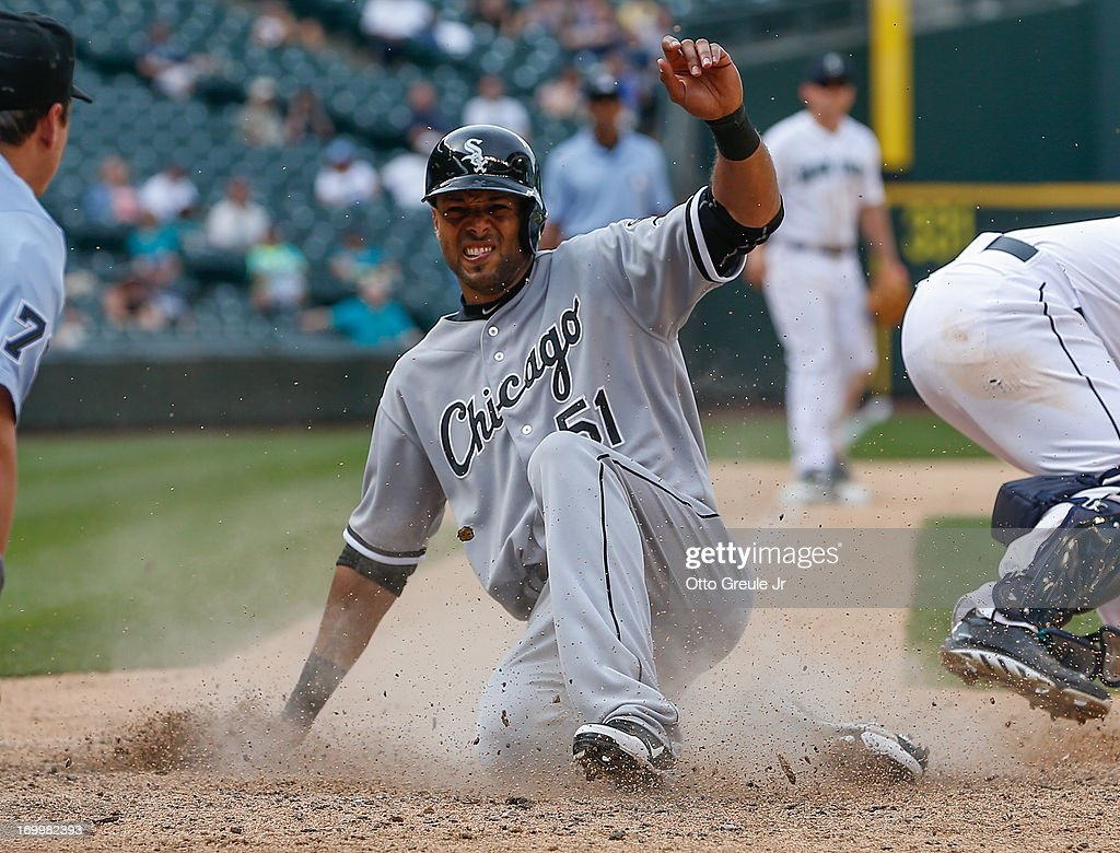 <a gi-track='captionPersonalityLinkClicked' href=/galleries/search?phrase=Alex+Rios&family=editorial&specificpeople=224676 ng-click='$event.stopPropagation()'>Alex Rios</a> #51 of the Chicago White Sox scores on an RBI single by Casper Wells in the fourteenth inning against the Seattle Mariners at Safeco Field on June 5, 2013 in Seattle, Washington.