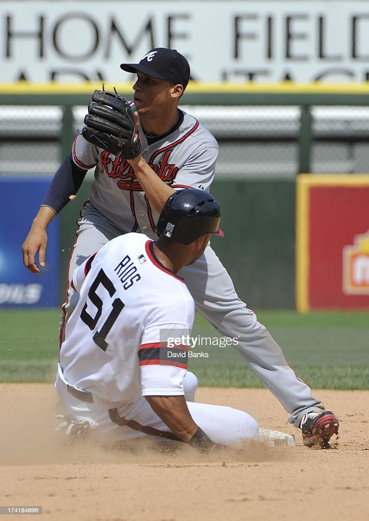 <a gi-track='captionPersonalityLinkClicked' href=/galleries/search?phrase=Alex+Rios&family=editorial&specificpeople=224676 ng-click='$event.stopPropagation()'>Alex Rios</a> #51 of the Chicago White Sox steals second base as <a gi-track='captionPersonalityLinkClicked' href=/galleries/search?phrase=Andrelton+Simmons&family=editorial&specificpeople=8978424 ng-click='$event.stopPropagation()'>Andrelton Simmons</a> #19 of the Atlanta Braves makes a late tag during the sixth inning on July 21, 2013 at U.S. Cellular Field in Chicago, Illinois.