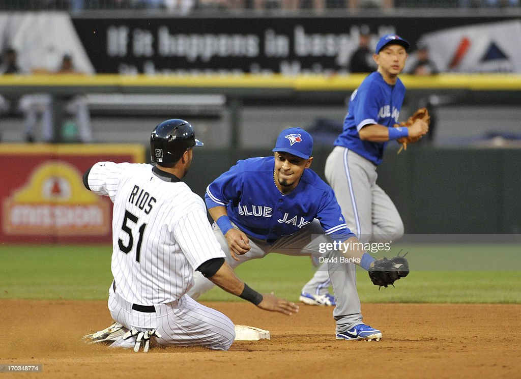 <a gi-track='captionPersonalityLinkClicked' href=/galleries/search?phrase=Alex+Rios&family=editorial&specificpeople=224676 ng-click='$event.stopPropagation()'>Alex Rios</a> #51 of the Chicago White Sox steals second base as <a gi-track='captionPersonalityLinkClicked' href=/galleries/search?phrase=Maicer+Izturis&family=editorial&specificpeople=239100 ng-click='$event.stopPropagation()'>Maicer Izturis</a> #3 of the Toronto Blue Jays makes a late tag during the fourth inning on June 11, 2013 at U.S. Cellular Field in Chicago, Illinois.