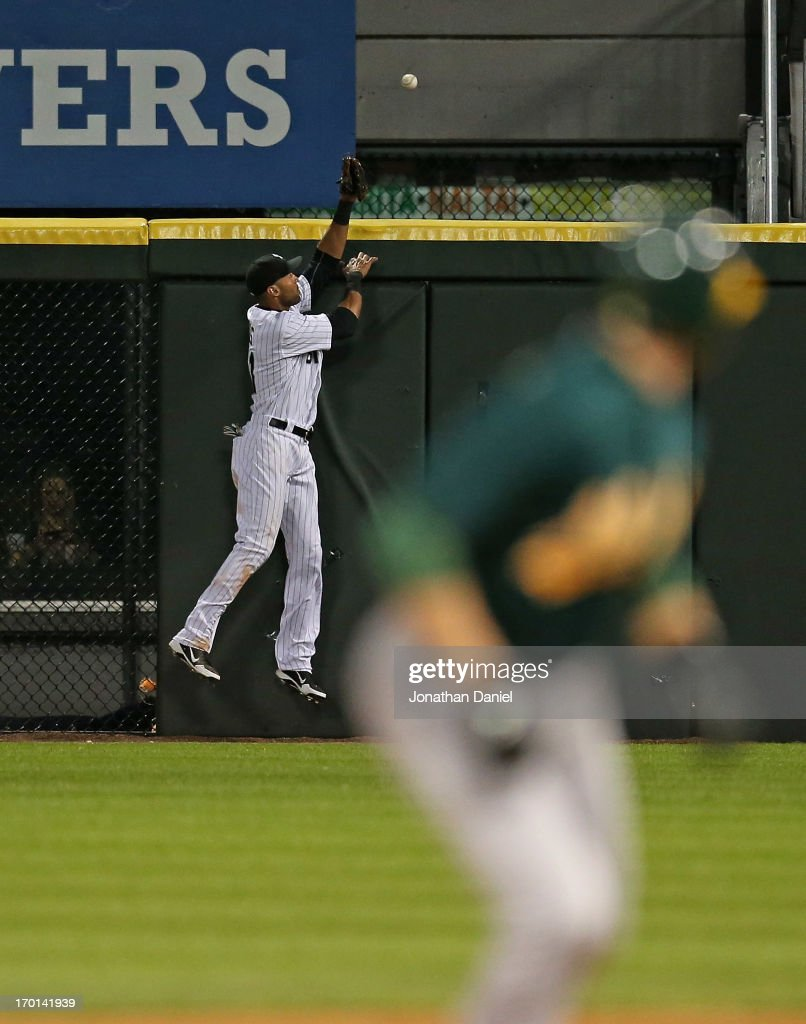 <a gi-track='captionPersonalityLinkClicked' href=/galleries/search?phrase=Alex+Rios&family=editorial&specificpeople=224676 ng-click='$event.stopPropagation()'>Alex Rios</a> #51 of the Chicago White Sox tries to reach a grand slam home run ball hit by Josh Donaldson of the Oakland Athletics at U.S. Cellular Field on June 7, 2013 in Chicago, Illinois.
