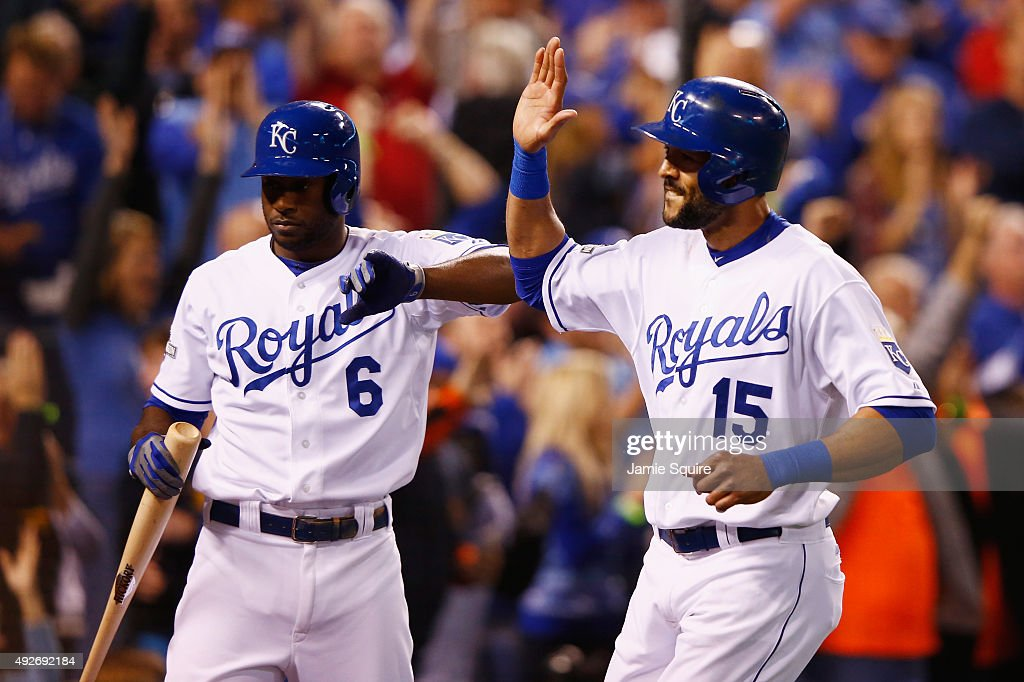 Alex Rios #15 of the Kansas City Royals celebrates with Lorenzo Cain #6 of the Kansas City Royals after scoring a run in the fifth inning against the Houston Astros during game five of the American League Divison Series at Kauffman Stadium on October 14, 2015 in Kansas City, Missouri.