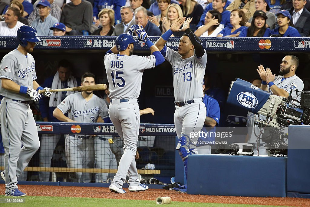 <a gi-track='captionPersonalityLinkClicked' href=/galleries/search?phrase=Alex+Rios&family=editorial&specificpeople=224676 ng-click='$event.stopPropagation()'>Alex Rios</a> #15 of the Kansas City Royals celebrates with Salvador Perez #13 of the Kansas City Royals after hitting a solo home run in the second inning against the Toronto Blue Jays during game four of the American League Championship Series at Rogers Centre on October 20, 2015 in Toronto, Canada.