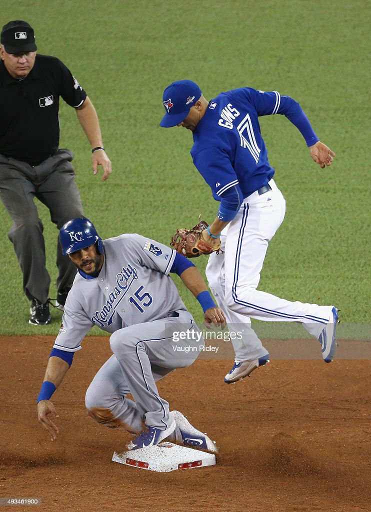 Alex Rios #15 of the Kansas City Royals is tagged out by Ryan Goins #17 of the Toronto Blue Jays as he attempts to steal second base in the fourth inning during game four of the American League Championship Series between the Toronto Blue Jays and the Kansas City Royals at Rogers Centre on October 20, 2015 in Toronto, Canada. Rios was called safe, but the call was overturned upon review.
