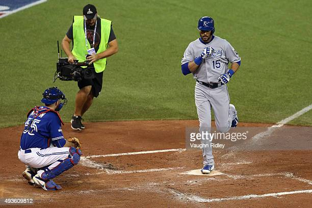 Alex Rios of the Kansas City Royals scores after hitting a solo home run in the second inning against the Toronto Blue Jays during game four of the...
