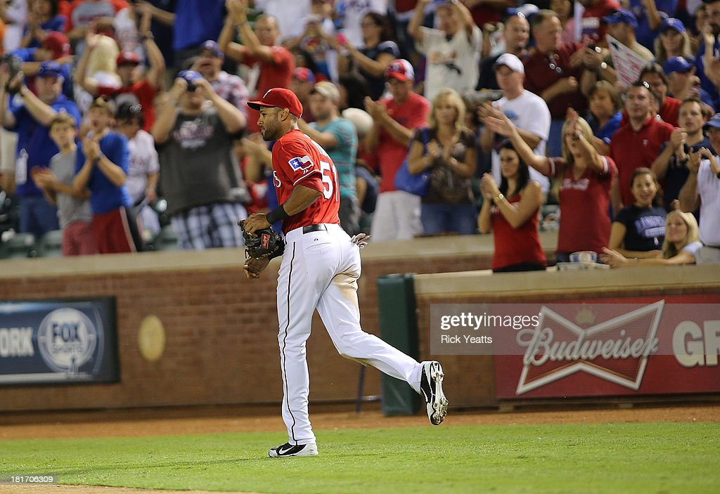 <a gi-track='captionPersonalityLinkClicked' href=/galleries/search?phrase=Alex+Rios&family=editorial&specificpeople=224676 ng-click='$event.stopPropagation()'>Alex Rios</a> #51 of the Texas Rangers is cheered by the crowd after hitting an RBI triple in the sixth inning to complete a cycle during a game against the Houston Astros at Rangers Ballpark in Arlington on September 23, 2013 in Arlington, Texas. Rios hit a two-run double in the first inning, a single in the third, and a solo home run in the fourth.