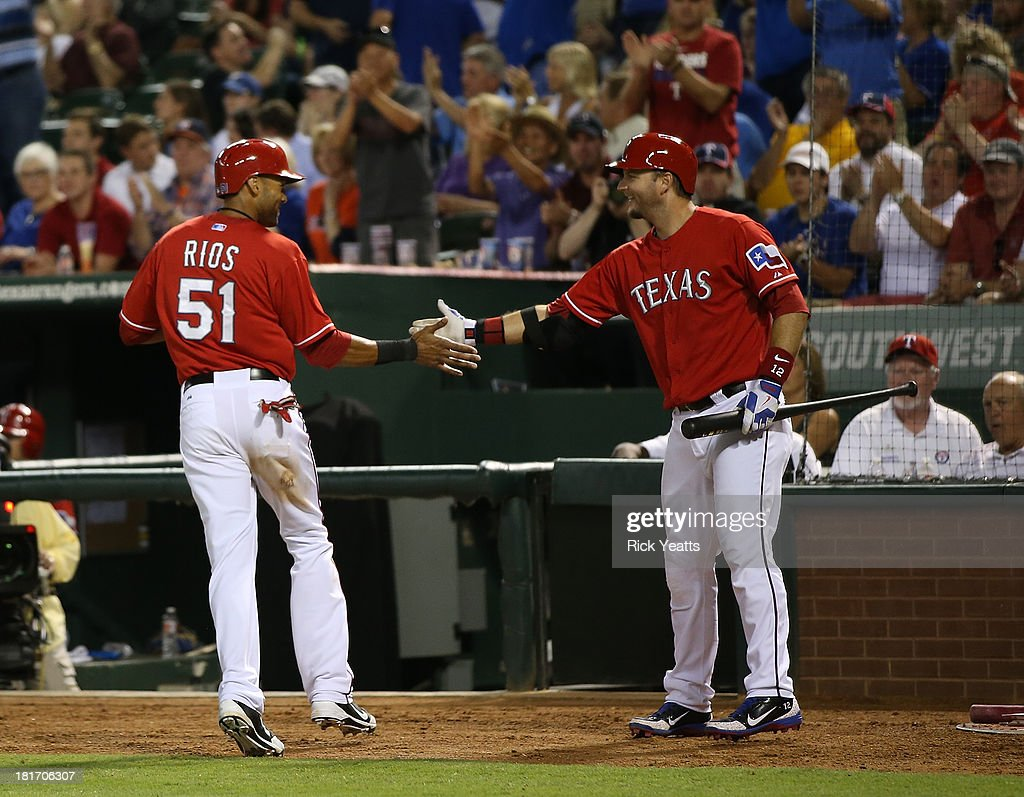 <a gi-track='captionPersonalityLinkClicked' href=/galleries/search?phrase=Alex+Rios&family=editorial&specificpeople=224676 ng-click='$event.stopPropagation()'>Alex Rios</a> #51 of the Texas Rangers is congratulated by <a gi-track='captionPersonalityLinkClicked' href=/galleries/search?phrase=A.J.+Pierzynski&family=editorial&specificpeople=204486 ng-click='$event.stopPropagation()'>A.J. Pierzynski</a> #12 after hitting an RBI triple in the sixth inning to complete a cycle during a game against the Houston Astros at Rangers Ballpark in Arlington on September 23, 2013 in Arlington, Texas. Rios hit a two-run double in the first inning, a single in the third, and a solo home run in the fourth.