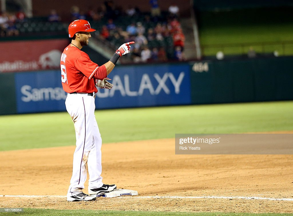 <a gi-track='captionPersonalityLinkClicked' href=/galleries/search?phrase=Alex+Rios&family=editorial&specificpeople=224676 ng-click='$event.stopPropagation()'>Alex Rios</a> #51 of the Texas Rangers motions to the dugout after hitting an RBI triple in the sixth inning to complete a cycle during a game against the Houston Astros at Rangers Ballpark in Arlington on September 23, 2013 in Arlington, Texas. Rios hit a two-run double in the first inning, a single in the third, and a solo home run in the fourth.