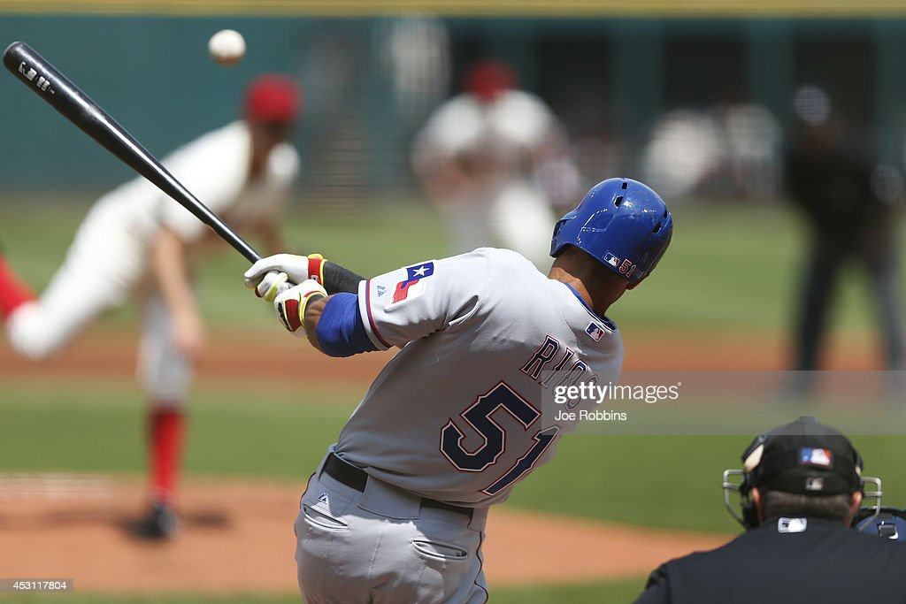 <a gi-track='captionPersonalityLinkClicked' href=/galleries/search?phrase=Alex+Rios&family=editorial&specificpeople=224676 ng-click='$event.stopPropagation()'>Alex Rios</a> #51 of the Texas Rangers singles to drive in a run in the first inning of the game against the Cleveland Indians at Progressive Field on August 3, 2014 in Cleveland, Ohio.