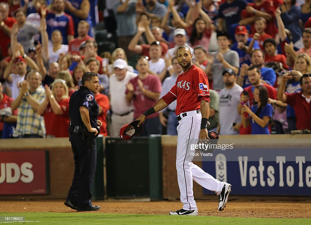 <a gi-track='captionPersonalityLinkClicked' href=/galleries/search?phrase=Alex+Rios&family=editorial&specificpeople=224676 ng-click='$event.stopPropagation()'>Alex Rios</a> #51 of the Texas Rangers waves his cap after hitting an RBI triple in the sixth inning to complete a cycle during a game against the Houston Astros at Rangers Ballpark in Arlington on September 23, 2013 in Arlington, Texas. Rios hit a two-run double in the first inning, a single in the third, and a solo home run in the fourth.