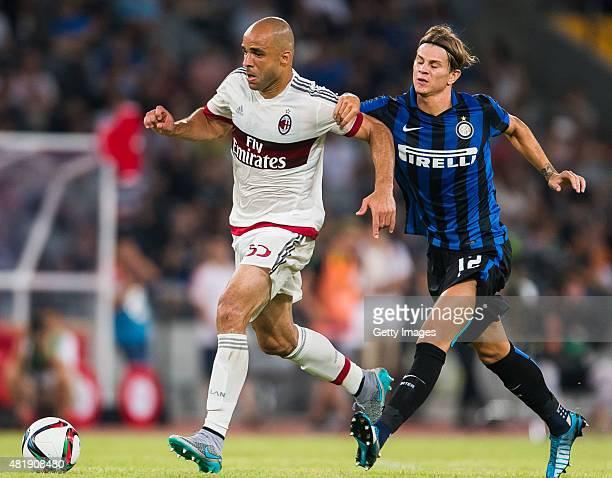 Alex Rodrigo Dias Da Costa of AC Milan competes for the ball with Samuele Longo of FC Internazionale Milano during the AC Milan vs FC Internacionale...