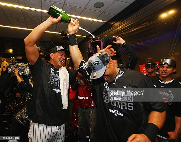 Alex Rodriguez and Carlos Beltran of the New York Yankees celebrates 41 win against the Boston Red Sox and their wildcard playoff berth after their...