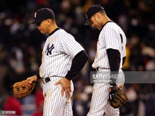 Alex Rodriguez and Derek Jeter of the New York Yankees walk back to the dugout after the end of the eighth inning against the Boston Red Sox during...