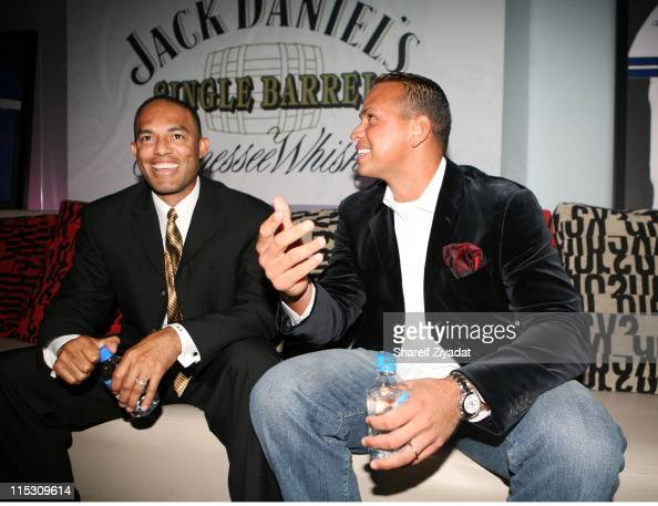 Alex Rodriguez and Mariano Rivera during Alex Rodriguez and Jay Z Celebrity Poker Tournament Inside at 40/40 Club in New York United States