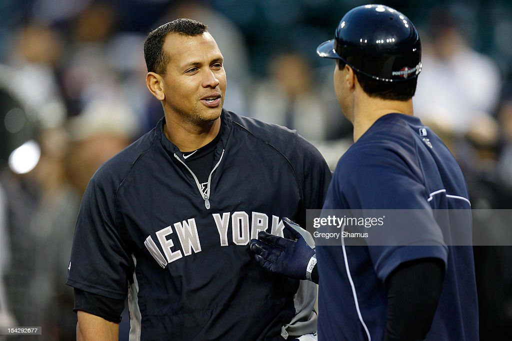 Alex Rodriguez #13 and Mark Teixeira #25 of the New York Yankees talk during batting practice against the Detroit Tigers during game four of the American League Championship Series at Comerica Park on October 17, 2012 in Detroit, Michigan.