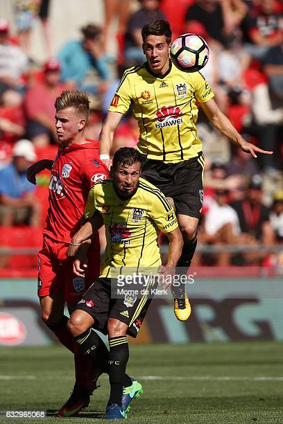 Alex Rodriguez and Vince Lia of Wellington Phoenix compete for the ball during the round 17 ALeague match between Adelaide United and the Wellington...