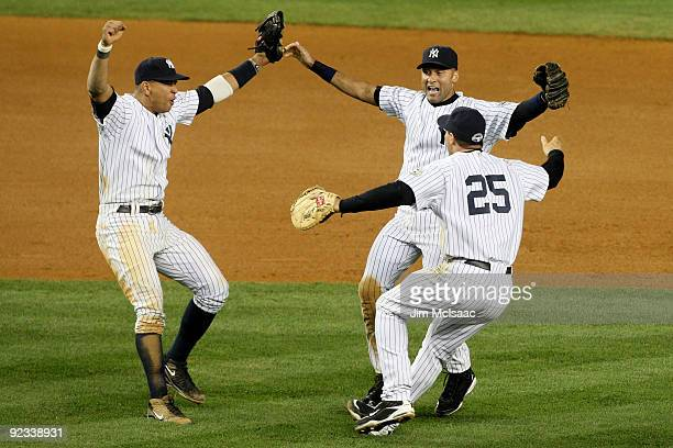 Alex Rodriguez Derek Jeter and Mark Teixeira of the New York Yankees celebrate their 52 victory over the Los Angeles Angels of Anaheim at the end of...