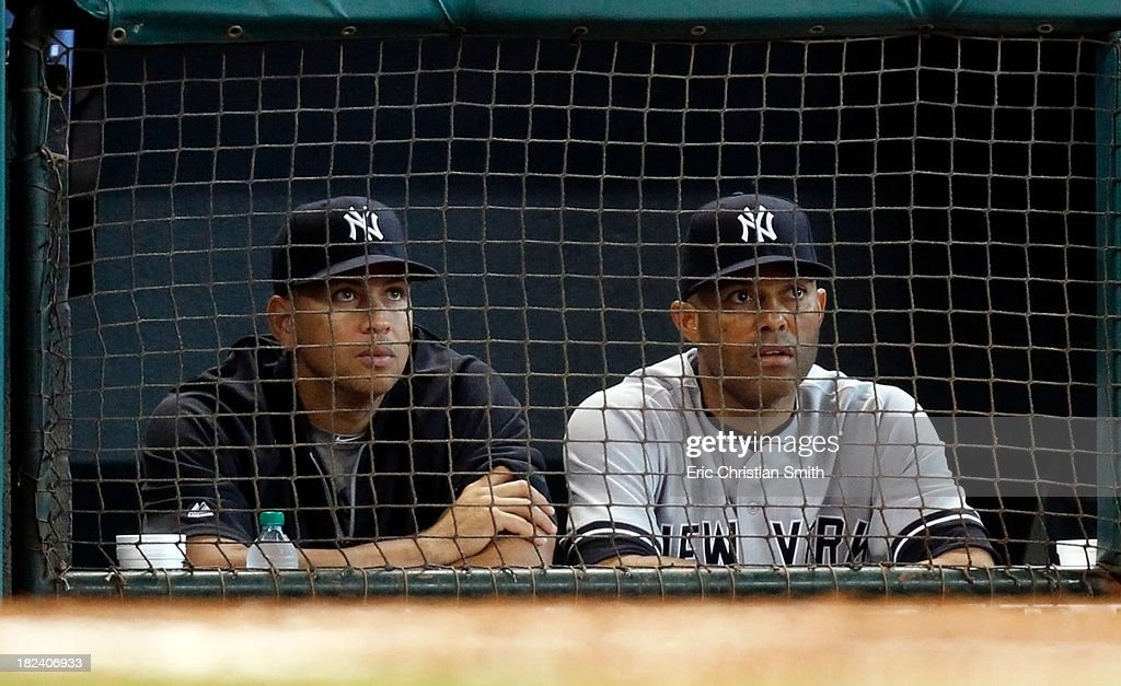 Alex Rodriguez #13, left, and Mariano Rivera #42 of the New York Yankees watch from the dugout during the ninth inning against the Houston Astros on September 29, 2013 at Minute Maid Park in Houston, TX.