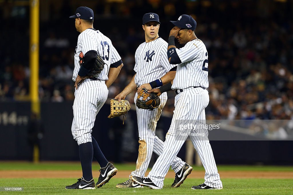 Alex Rodriguez #13, Mark Teixeira #25 and Robinson Cano #24 of the New York Yankees walk on the field late in the game against the Detroit Tigers during Game Two of the American League Championship Series at Yankee Stadium on October 14, 2012 in the Bronx borough of New York City.