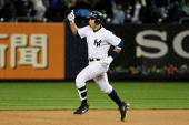 Alex Rodriguez of New York Yankees hits a solo home run to tie the game in the bottom of the eleventh inninng of Game Two of the ALCS against the Los...