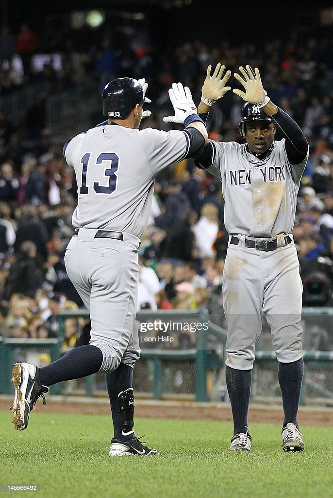 Alex Rodriguez #13 of the New York Yakees celebrates after hitting a two run home run scoring <a gi-track='captionPersonalityLinkClicked' href=/galleries/search?phrase=Curtis+Granderson&family=editorial&specificpeople=546997 ng-click='$event.stopPropagation()'>Curtis Granderson</a> #14 in the ninth inning during the game against the Detroit Tigers at Comerica Park on June 1, 2012 in Detroit, Michigan. The Yankees defeated the Tigers 9-4.