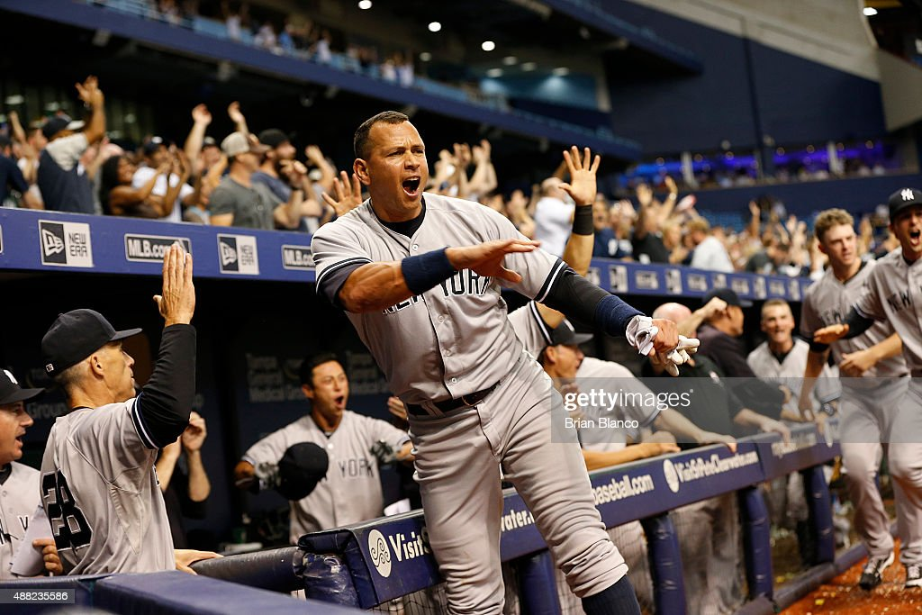 <a gi-track='captionPersonalityLinkClicked' href=/galleries/search?phrase=Alex+Rodriguez+-+Baseball+Player&family=editorial&specificpeople=167080 ng-click='$event.stopPropagation()'>Alex Rodriguez</a> #13 of the New York Yankees and manager <a gi-track='captionPersonalityLinkClicked' href=/galleries/search?phrase=Joe+Girardi&family=editorial&specificpeople=208659 ng-click='$event.stopPropagation()'>Joe Girardi</a> #28 celebrate after Slade Heathcott #72 hit a three-run home run off of pitcher Brad Boxberger #26 of the Tampa Bay Rays during the ninth inning of a game on September 14, 2015 at Tropicana Field in St. Petersburg, Florida.