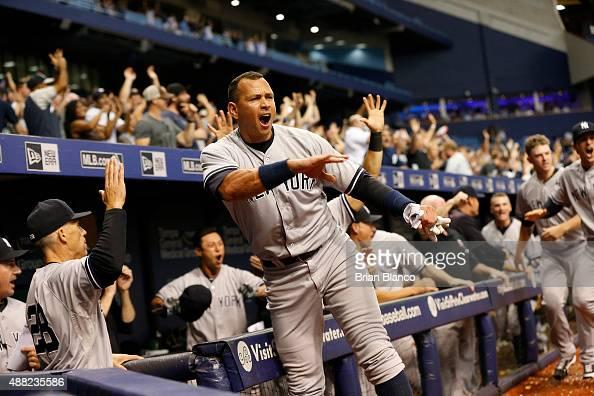 Alex Rodriguez of the New York Yankees and manager Joe Girardi celebrate after Slade Heathcott hit a threerun home run off of pitcher Brad Boxberger...