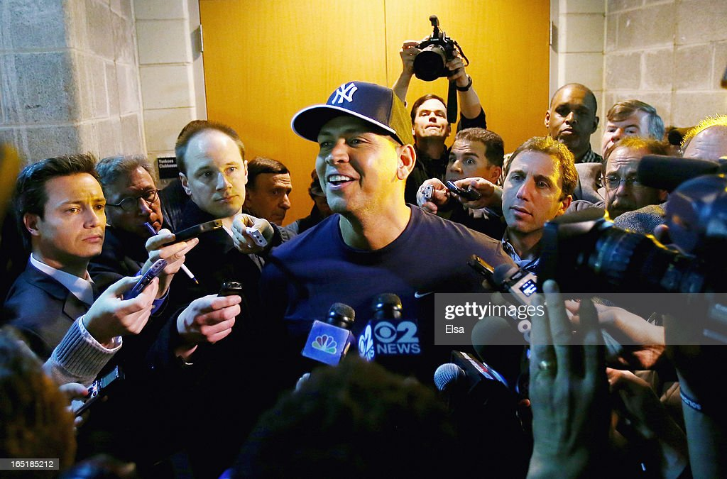 Alex Rodriguez #13 of the New York Yankees answers questions outside the clubhouse before the game against the Boston Red Sox during Opening Day on April 1, 2013 at Yankee Stadium in the Bronx borough of New York City.