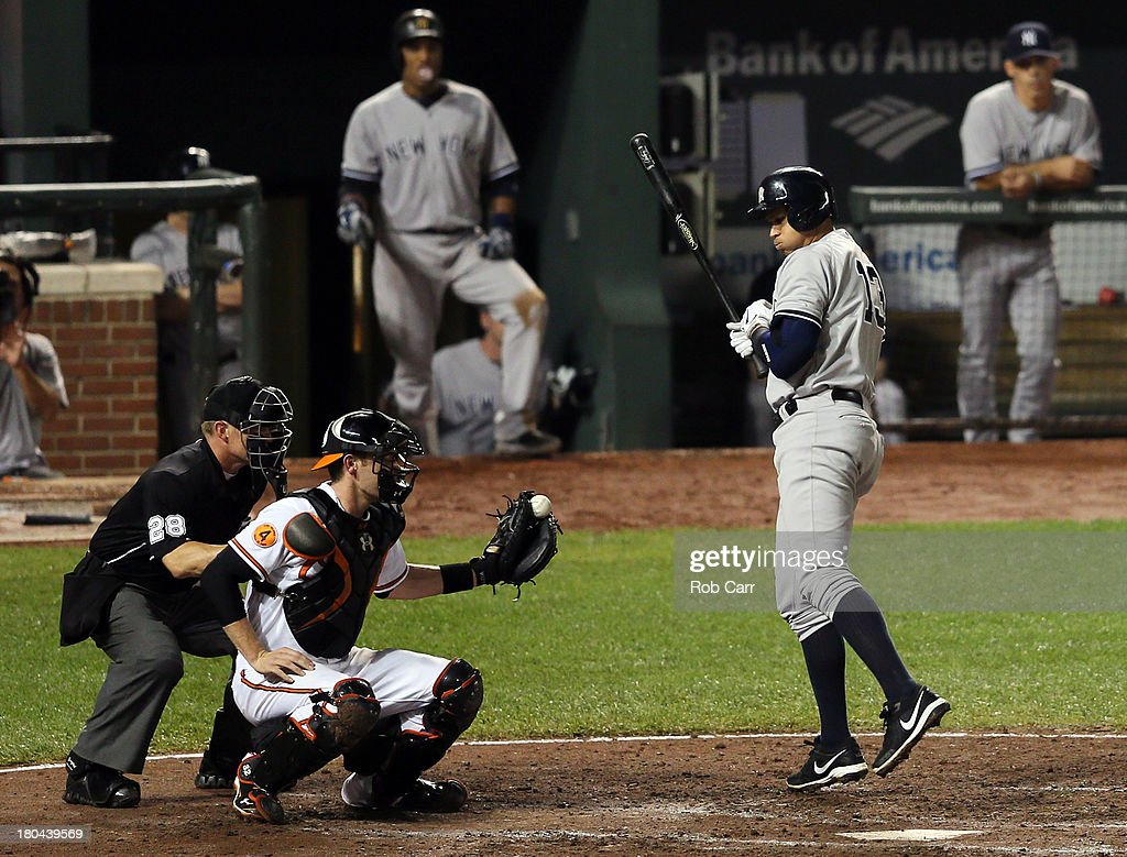 Alex Rodriguez #13 of the New York Yankees avoids being hit by a pitch as catcher <a gi-track='captionPersonalityLinkClicked' href=/galleries/search?phrase=Matt+Wieters&family=editorial&specificpeople=4498276 ng-click='$event.stopPropagation()'>Matt Wieters</a> #32 of the Baltimore Orioles catches the ball during the seventh inning at Oriole Park at Camden Yards on September 12, 2013 in Baltimore, Maryland.