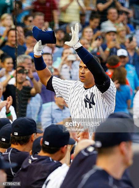 Alex Rodriguez of the New York Yankees celebrates after his 3000th career hit a first inning home run against the Detroit Tigers at Yankee Stadium on...