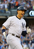Alex Rodriguez of the New York Yankees celebrates after hitting a home run as well as getting his 3000th career hit in the first inning against the...