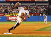 Alex Rodriguez of the New York Yankees celebrates as he heads for home with the winning run against the Toronto Blue Jays during their game at Yankee...