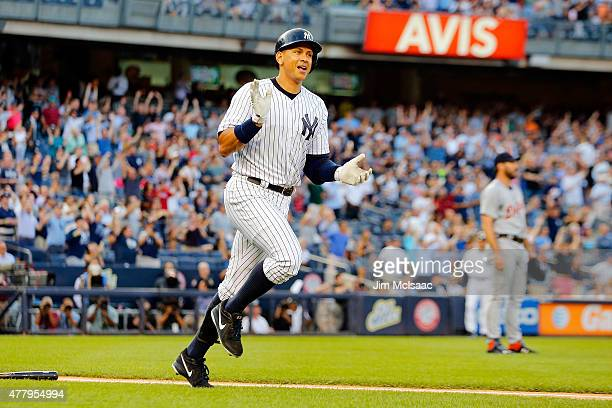 Alex Rodriguez of the New York Yankees celebrates as he runs the bases after his 3000th career hit a first inning home run as Justin Verlander of the...
