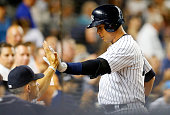 Alex Rodriguez of the New York Yankees celebrates his fourth inning home run against the Cleveland Indians at Yankee Stadium on August 20 2015 in the...