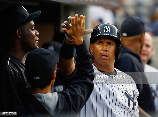 Alex Rodriguez of the New York Yankees celebrates his home run against the Baltimore Orioles in the second inning during their game at Yankee Stadium...