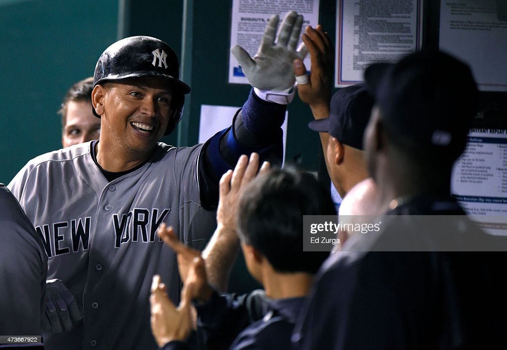 Alex Rodriguez #13 of the New York Yankees celebrates his home run with teammates in the ninth inning against the Kansas City Royals at Kauffman Stadium on May 16, 2014 in Kansas City, Missouri.