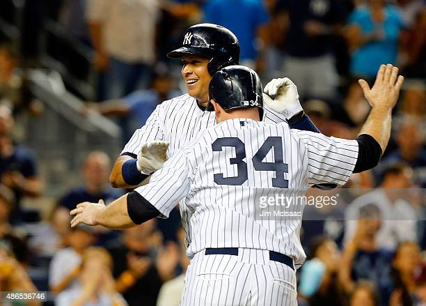 Alex Rodriguez of the New York Yankees celebrates his second inning two run home run against the Tampa Bay Rays with teammate Brian McCann at Yankee...