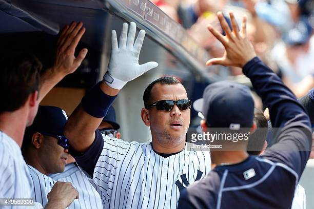 Alex Rodriguez of the New York Yankees celebrates his sixth inning home run against the Tampa Bay Rays at Yankee Stadium on July 5 2015 in the Bronx...