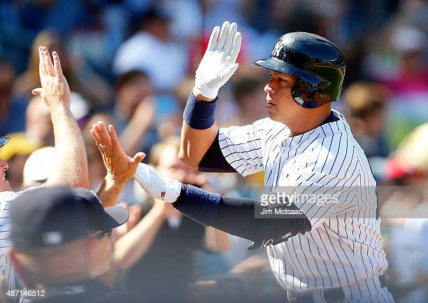 Alex Rodriguez of the New York Yankees celebrates his sixth inning home run against the Tampa Bay Rays at Yankee Stadium on September 6 2015 in the...