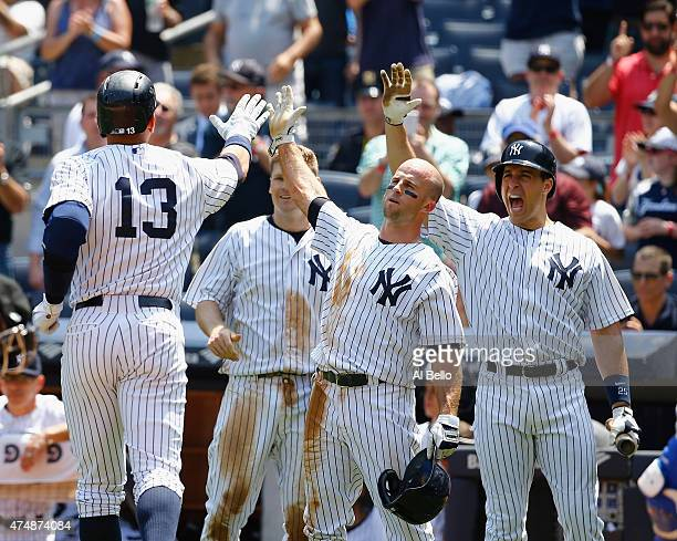 Alex Rodriguez of the New York Yankees celebrates his threerun home run with Brett Gardner and Mark Teixeira in the third inning against Chris Young...
