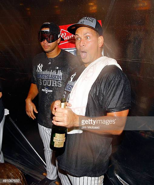 Alex Rodriguez of the New York Yankees celebrates in the locker room after defeating the Boston Red Sox at Yankee Stadium on October 1 2015 in the...