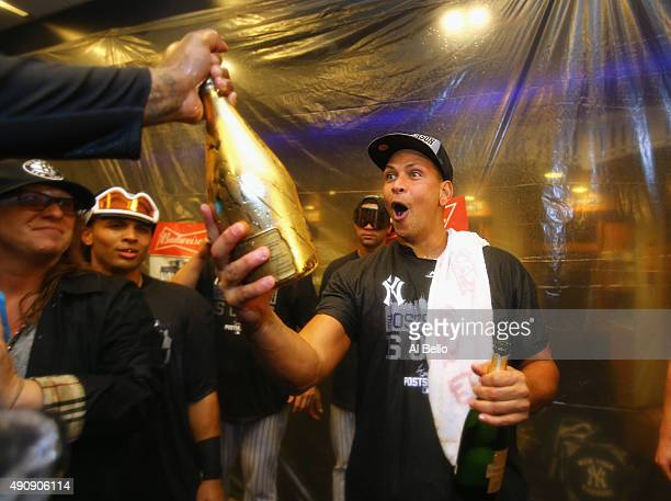 Alex Rodriguez of the New York Yankees celebrates their 41 win against the Boston Red Sox and their wildcard playoff berth after their game at Yankee...