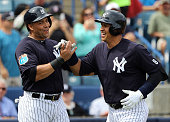 Alex Rodriguez of the New York Yankees celebrates with Carlos Beltran after hitting a two run home run in the first inning during the game against...