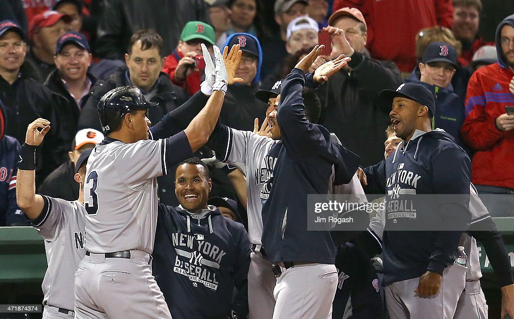 Alex Rodriguez #13 of the New York Yankees celebrates with Joe Girardi #28 of the New York Yankees after hit his 660th career home run to tie Willie Mays during a game with Boston Red Sox in the 8th inning at Fenway Park May 1, 2015 in Boston, Massachusetts.