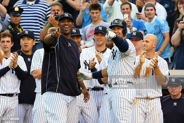 Alex Rodriguez of the New York Yankees celebrates with teammate CC Sabathia after hitting a solo home run in the first inning for his 3000th career...