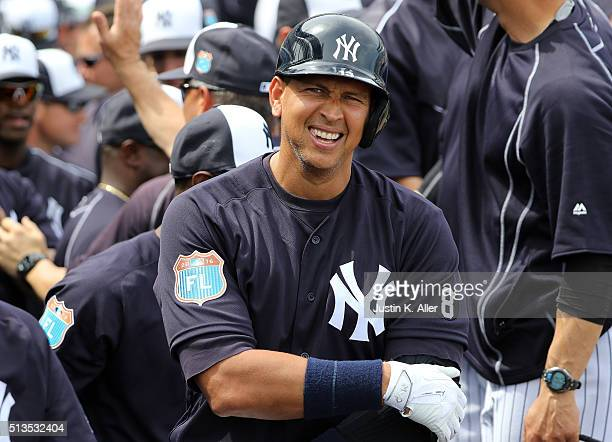 Alex Rodriguez of the New York Yankees celebrates with teammates after hitting a two run home run in the first inning during the game against the...